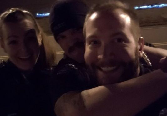The images showed the officers grinning as they re-enacted the chokehold on Elijah McCain