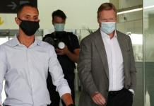 Ronald Koeman (right) arrived at Barcelona's El Prat airport on Tuesday