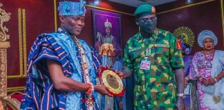 Olowu of Kuta presents General Buratai with a plaque after the construction of Tukur Yusuf Buratai Bailey Bridge commissioned by Governor Isiaka Oyetola of Osun State