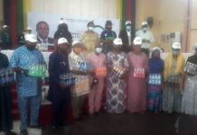 Cross-section of beneficiaries display their start-up products