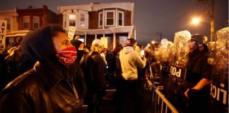 Philadelphia residents protest the killing of Wallace by two officers