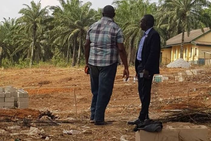 MayFlower Old Students Association President, Dr. Rotimi Akinlesi on a tour of the site
