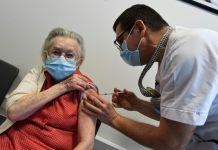 Elderly woman taking covid vaccine