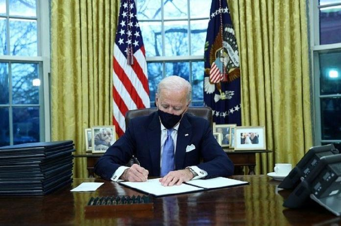President Biden is quickly signing executive actions on coronavirus, climate change and racial inequality