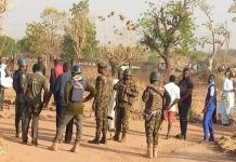 Soldiers and other security operatives outside the school where Kagara boys were abducted