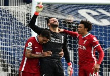 Alisson Becker headed an injury time winner to keep Liverpool in top four race