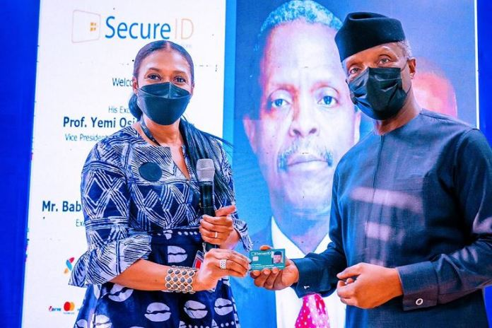 Kofo Akinkugbe, CEO SecureID presents Vice President Yemi Osinbajo with a smart card