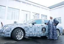 Princess Ronke Ademiluyi, CEO of Adire Oodua Textile Hub stands next to Ooni's branded Bentley