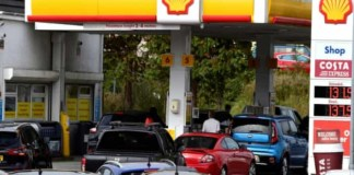 Cars queue for fuel at a Shell filling station in UK