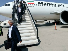 Passengers get off from a privately owned Iranian airline Mahan Air flight at the airport in Kabul on September 15, 2021 Afghanistan