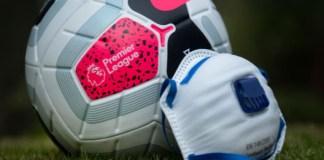 Premier League football beside a face mask