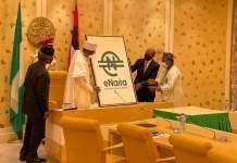 President Muhammadu Buhari unveiling the eNaira in Abuja on Monday