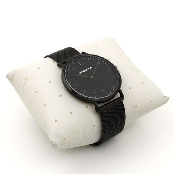all black watch on a display cushion
