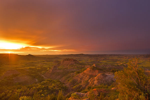 Sunset during thunderstorm at Painted Canyon in Theodore Roosevelt National Park; National Park, North Dakota, USA