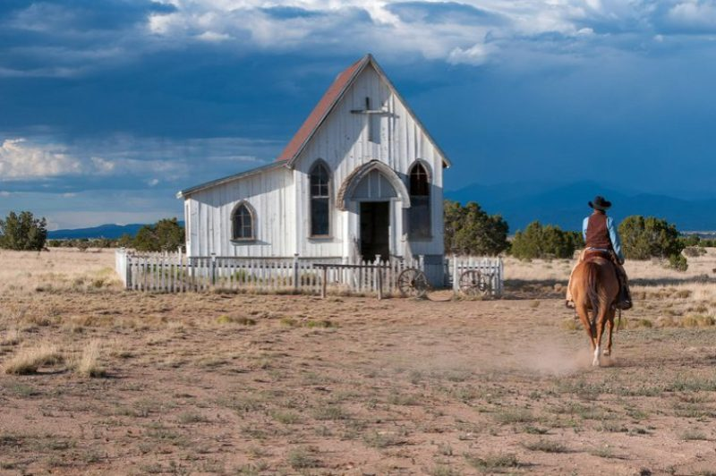 women-riding-horse-near-a-small-church-in-santa-fe-new-mexico_800