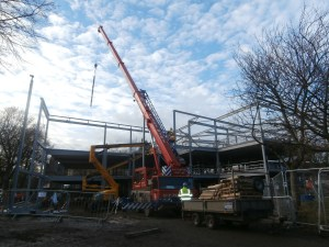 Crane in the process of lifting steel to the top floor of the new build.