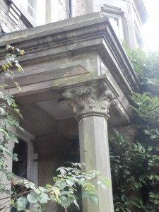 Evergreen takeover of Tankerville House column, capitol & pediment.