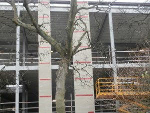 Two vertical sections of concrete board cladding are now in place.