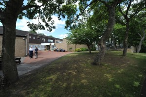 Dorothy Chipchase & Kay Murdoch walking through Junior School grounds.
