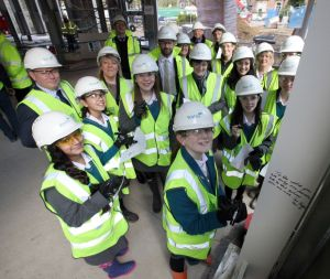 Wates' press photograph of the 'Topping Out' ceremony in the new-build.