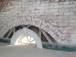 With the walls stripped back, the structure of the unusual semi-circular fanlight at foot level is fascinatingly exposed.