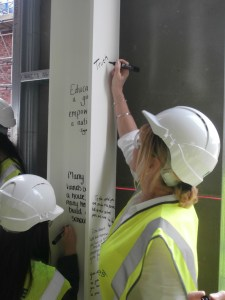 Church High 'Old Girl' Helen Harrison signs the beam on behalf of all Church High Alumnae.