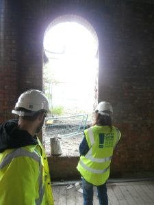 Circular hole in the north facade now opened up into an arched doorway.