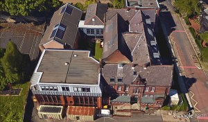 Different coloured slate at the back of the main building show where the dormer windows used to be (Google Earth, March 2016).