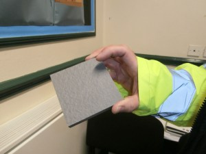 Nick White shows us a sample of the light grey paving stones which will be used for hard landscaping around the site.