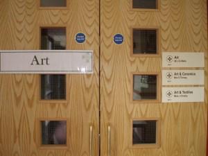 The familiar light wood doors of the Church High Art Department.