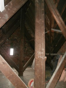 The only surviving king-post trusses are to be be sealed off by a stud wall eventually.