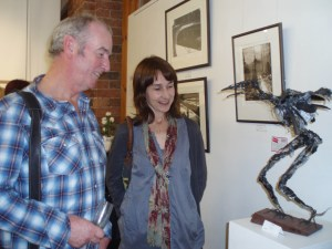 Zoe Robinson's trademark is wire sculptures, here being viewed by writer David Almond at The Biscuit Factory.