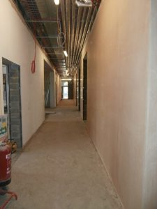 The newly-skimmed walls of the bottom corridor.