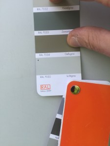On the other, Man prepares to paint over the green with grey. green