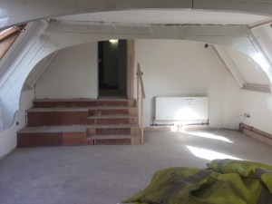 The western south-gable eaves room looking east.