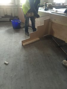 A joiner begins work on the steps.