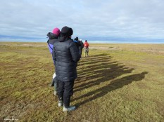 People on the tundra at Nanuk Polar Bear Lodge.