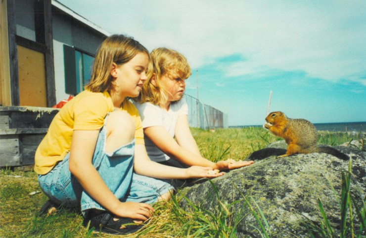 Hand feeding sik-siks while growing up at Seal River.