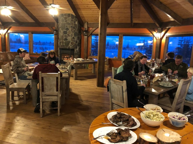 Warming up over dinner in the lodge as dusk falls.