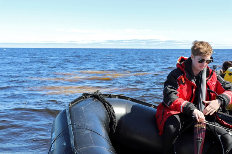 Cellist Rob Knaggs performs with the beluga whales of Hudson Bay near Seal River.