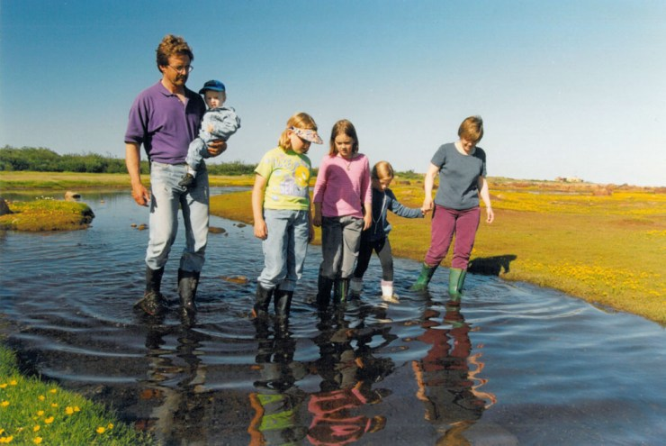Early days at Seal River. Reimer family walk on the Hudson Bay coast.