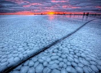 Icescape at sunset. Dymond Lake Ecolodge. Churchill Wild. Robert Postma photo.
