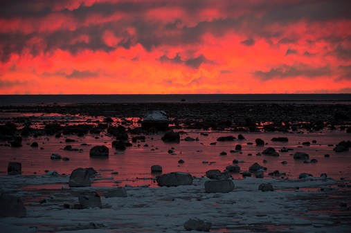 Red sunset at Seal River Heritage Lodge. Arturo Spanjani photo.