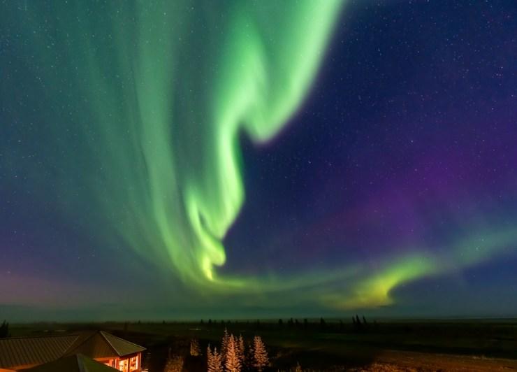 Northern lights over Nanuk Polar Bear Lodge. Photo courtesy of An Xiao.