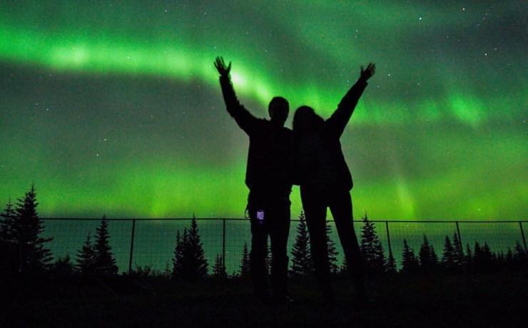 Immersed in the aurora borealis at Nanuk Polar Bear Lodge.