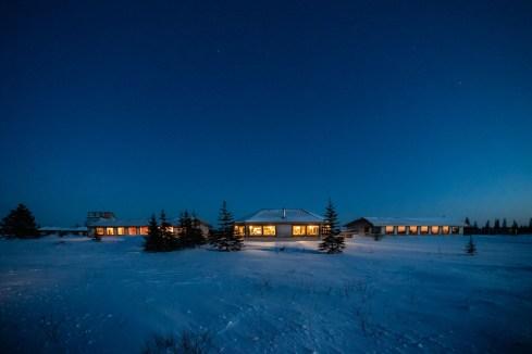 Nanuk Polar Bear Lodge lit up at night.