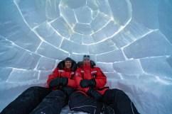 Christoph and Fabienne Jansen in igloo at Nanuk Polar Bear Lodge.