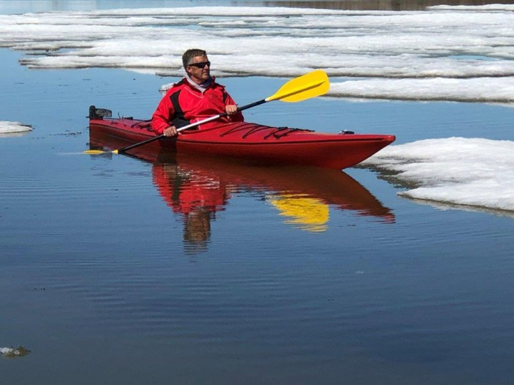 Mike Reimer. Looking for polar bears on Hudson Bay.