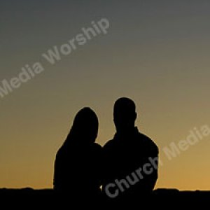 Couple in Worship Christian Worship Background. High quality worship images for use to spread the Gospel and enhance the worship experience.