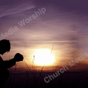 Man in prayer Christian Worship Background. High quality worship images for use to spread the Gospel and enhance the worship experience.